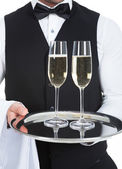 Waiter Carrying Champagne Flutes — Stock Photo