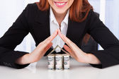Businesswoman Protecting House Of Dollar — Stock Photo