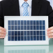 Businessman Holding Solar Panel — Stock Photo #49571295