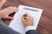Businessman Signing Contract At Table — Stock Photo