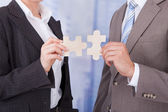 Business People Joining Jigsaw Pieces — Stock Photo