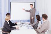 Businessman Giving Presentation — Stock Photo