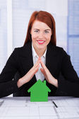 Businesswoman Sheltering House Model — Stock Photo