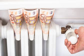 Euro banknotes stuck in radiator — Stock Photo