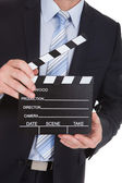 Businessman Holding Clapboard — Stock Photo