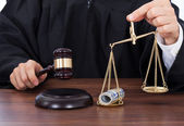 Judge Striking Gavel and Money — Stock Photo