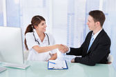 Doctor Greeting Businessman — Stock Photo