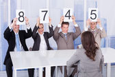 Business People Showing Score Cards — Stock Photo