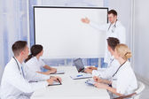 Doctor Giving Presentation — Stock Photo