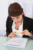Businesswoman Examining Contract — Stock Photo