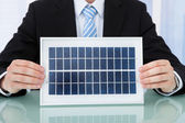 Businessman Holding Solar Panel — Stock Photo