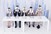 Business People Showing Score Cards — 图库照片