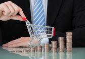 Shopping Cart And Coin Stacks — Stock Photo