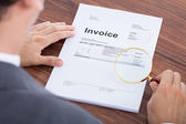 Businessman Examining Invoice — Stock Photo