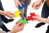 Friends Holding Jigsaw Pieces — Stock Photo