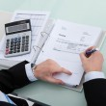 Businessman Calculating Finance — Stock Photo #49939155