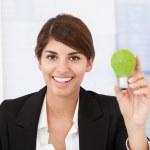 Businesswoman Holding  Light Bulb — Stock Photo #49939999