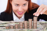 Businesswoman Stacking Coins — Stock Photo