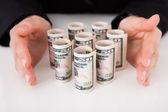 Businesswoman Shielding  Dollar Bills — Stock Photo