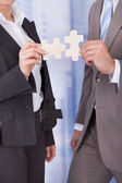 Business People Joining Jigsaw — Stock Photo