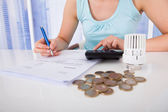 Woman Calculating Invoice — Stock Photo