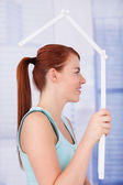 Woman Looking Through House Frame — Stock Photo