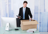 Businessman Collecting Office Supply — Stockfoto