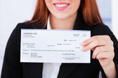 Businesswoman Holding Cheque — Stock Photo