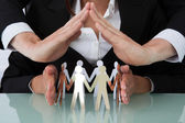 Business People Sheltering Team — Stock Photo