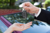 Salesman giving Key To Woman — Stock Photo