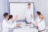Doctors Clapping For Colleague — Stock Photo