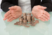 Businesswoman Sheltering Coins — Stock Photo