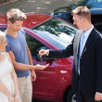 Salesman Giving Key To Couple — Stock Photo #50343303