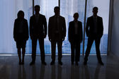 Silhouettes of Business People — Stock Photo