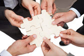Businesspeople Fixing Jigsaw Pieces — Stock Photo