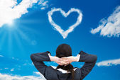 Businesswoman andt Heart Shaped Cloud — Stock Photo