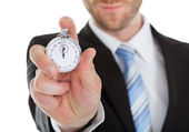 Businessman Showing Stopwatch — Stock Photo