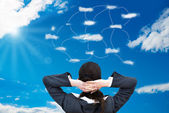 Businesswoman Looking At  Clouds — Stock Photo