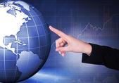 Businesswoman Touching Globe — Stock Photo