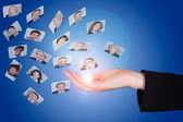 Businesswoman's Hand With Photographs — Stock Photo