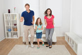 Happy Family Pretending To Run — Stock Photo