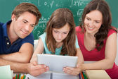 Parents Assisting Daughter with  Tablet — Stock Photo