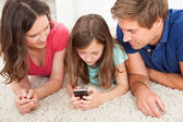 Parents and  Daughter Using Smart Phone — Stock Photo