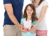 Family Holding Piggy Bank — Stock Photo