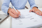 Businessman Calculating Invoice — Stock Photo