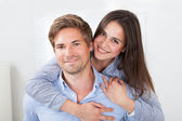 Man Giving Piggyback  To Woman — Stock Photo
