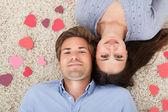 Couple Lying On Rug — Stockfoto