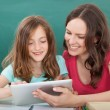 Woman and Girl Using Digital Tablet — Stock Photo #51170893