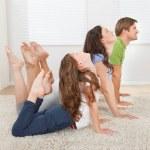 Active Family Doing Yoga — Stock Photo #51171235
