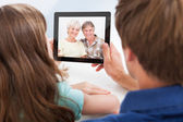 Daughter With Father Chatting On Digital Tablet — Stock Photo